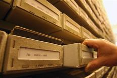 File photo of an archivist retrieving a file at the International Tracing Service (ITS) the world's biggest Holocaust archive, in the central German town of Bad Arolsen May 10, 2006. REUTERS/Alex Grimm/Files