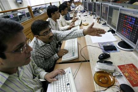 Stock brokers engage in trading at a brokerage firm in Mumbai February 14, 2008. REUTERS/Arko Datta/Files