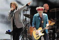 "Mick Jagger (L) and Keith Richards perform onstage during the Rolling Stones final concert of their ""50 and Counting Tour"" in Newark, New Jersey, December 15, 2012. REUTERS/Carlo Allegri"