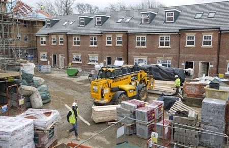 Construction workers build a new residential property development in north London, March 21, 2013. REUTERS/Neil Hall