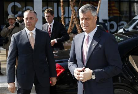 Kosovo's Prime Minister Hashim Thaci (R) arrives for a meeting with Serbian Prime Minister Ivica Dacic (unseen) and European Union foreign policy chief Catherine Ashton (unseen) in Brussels April 2, 2013. REUTERS/Francois Lenoir