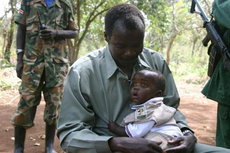 Lord's Resistance Army (LRA) leader Major General Joseph Kony, holds his son, Opiyo, in this exclusive image, at peace negotiations between the LRA and Ugandan religious and cultural leaders in Ri-Kwangba, southern Sudan, November 30, 2008. REUTERS/Africa24 Media/Files