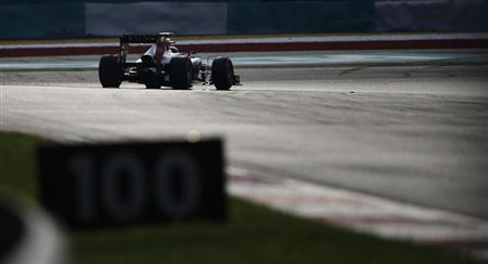 Red Bull Formula One driver Mark Webber of Australia drives during the Malaysian F1 Grand Prix at Sepang International Circuit outside Kuala Lumpur, March 24, 2013. REUTERS/Tim Chong