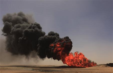 Flames and smoke rise at an oil pipeline after an explosion, 18 km (11 miles) south of the city of Ajdabiyah April 3, 2013. REUTERS/Esam Al-Fetori