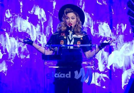 Singer Madonna presents the Vito Russo Award to journalist Anderson Cooper (not seen) during the 24th Annual GLAAD Media Awards in New York, March 16, 2013. REUTERS/Carlo Allegri
