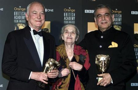 (L-R) James Ivory, Ruth Prawer Jhabvala and Ismail Merchant, who together form Merchant Ivory Productions, receive a British Academy film fellowship at a ceremony in central London, February 24, 2002. REUTERS/Michael Crabtree/Files