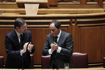 Portugal's Prime Minister Pedro Passos Coelho (L) reacts near Foreign Affairs Minister Paulo Portas during the debate on the no-confidence motion at the parliament in Lisbon April 3, 2013. REUTERS/Hugo Correia