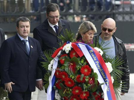 Serbian Prime Minister Ivica Dacic (L) and Deputy Prime Minister Aleksandar Vucic (2nd L) arrive to lay a wreath in a memory of late Prime Minister Zoran Djindjic in front of Serbian government building where he was assassinated ten years ago in Belgrade March 12, 2013. REUTERS/Djordje Kojadinovic