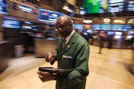 A trader works on the floor of the New York Stock Exchange after the closing bell, March 8, 2013. REUTERS/Lucas Jackson