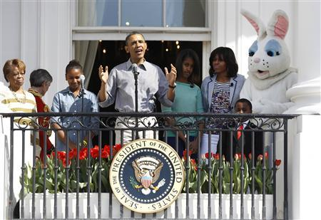 U.S. President Barack Obama speaks alongside first lady Michelle (2nd R), their daughters Sasha (2nd L) and Malia (3rd R), Michelle Obama's mother Marian Robinson (L) and the Easter Bunny as they participate in the 135th annual Easter Egg Roll on the South Lawn of the White House in Washington, April 1, 2013. REUTERS/Jason Reed