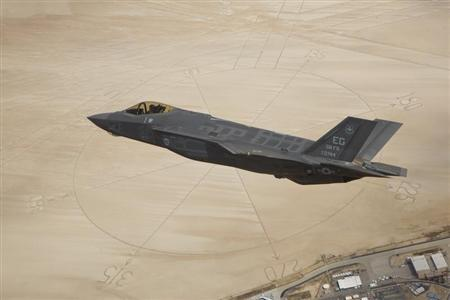 The F-35A Lightning II flies above the compass rose of Rogers Dry Lakebed at Edwards Air Force Base, May 13, 2011. REUTERS/Paul Weatherman/Lockheed Martin/US Air Force