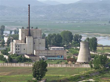 A North Korean nuclear plant is seen before demolishing a cooling tower (R) in Yongbyon, in this photo taken June 27, 2008 and released by Kyodo. REUTERS/Kyodo/Files