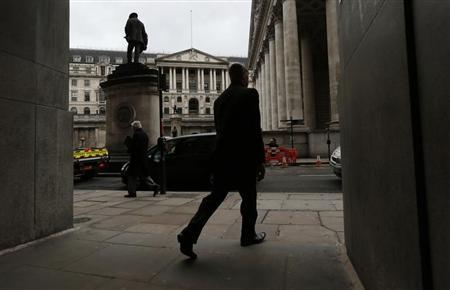 A man walks out of a passageway close to the Bank of England in the City of London March 15, 2013. REUTERS/Suzanne Plunkett
