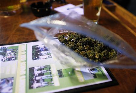 A customer's bag of one ounce of marijuana sits at the table at a sports bar in Olympia, Washington on December 9, 2012. REUTERS/Nick Adams
