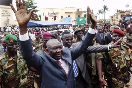 Central African Republic's new leader Michel Djotodia greets his supporters at a rally in favor of the Seleka rebel alliance in downtown Bangui March 30, 2013. REUTERS/Alain Amontchi