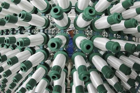 An employee works at a textile mill in Jiujiang, Jiangxi province, March 28, 2013. REUTERS/China Daily