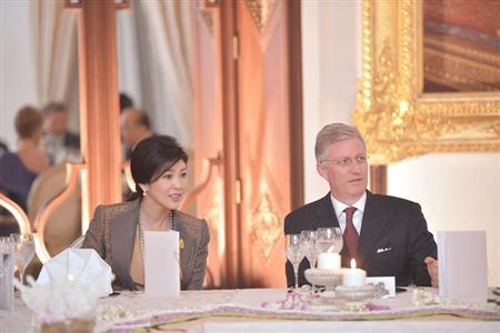 Belgian Crown Prince Philippe sits with Thailand's Prime Minister Yingluck Shinawatra during a visit at the Government House in Bangkok March 18, 2013. REUTERS/Government House/Handout (