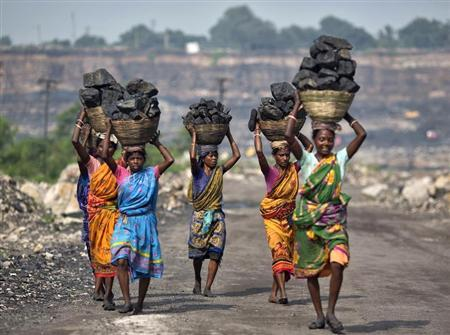 Local women carry coal taken from open cast coal field at Dhanbad district in Jharkhand September 19, 2012. REUTERS/Ahmad Masood