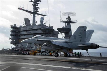 A F/A-18E Super Hornet assigned to the Gunslingers of Strike Fighter Squadron (VFA) 105 lands aboard the aircraft carrier USS Harry S. Truman in this January 15, 2013 handout photo courtesy of the U.S. Navy. REUTERS/U.S. Navy/Mass Communication Specialist 3rd Class Lorenzo J. Burleson/Handout