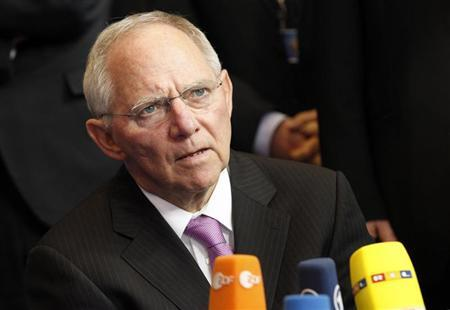 Germany's Finance Minister Wolfgang Schauble attends an interview as he arrives for a Eurogroup meeting at the European Council building in Brussels March 24, 2013. REUTERS/Sebastien Pirlet