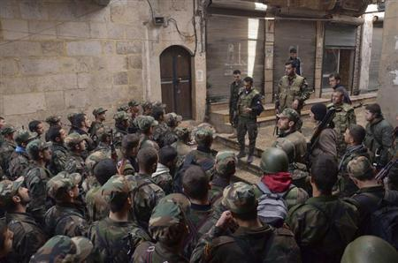 Forces loyal to Syria's President Bashar al-Assad get briefed before being deployed from the al-Sabaa Bahrat district to the old souk of Aleppo February 21, 2013. REUTERS/George Ourfalian