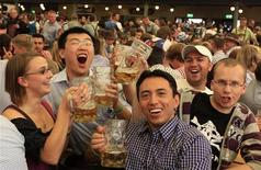 A Chinese tourist celebrates with German friends a beer at the famous Oktoberfest in Munich September 28, 2012. REUTERS/Michaela Rehle