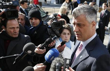 Kosovo's Prime Minister Hashim Thaci (R) talks to the media as he arrives for a meeting with Serbian Prime Minister Ivica Dacic (unseen) and European Union foreign policy chief Catherine Ashton (unseen) in Brussels April 2, 2013. REUTERS/Francois Lenoir