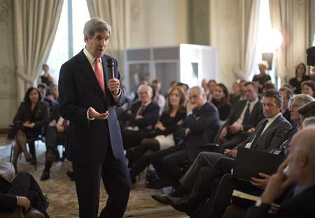 U.S. Secretary of State John Kerry speaks with French business leaders and entrepreneurs at the U.S. Ambassador Charles Rivkin's residence in Paris, March 27, 2013. REUTERS/Jason Reed