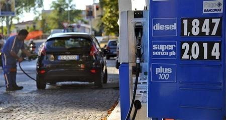 A signboard displays fuel prices at a petrol station in Florence, August 27, 2012. REUTERS/Stringer
