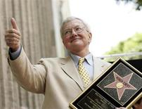 Movie critic Roger Ebert gives the thumbs-up after receiving a star on the Hollywood Walk of Fame in Hollywood June 23, 2005. Ebert passed away Thursday, according to the Chicago Sun-Times. REUTERS/Mario Anzuoni