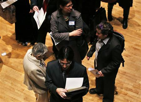 People wait in line to meet a job recruiter at the UJA-Federation Connect to Care job fair in New York in this March 6, 2013 file photo. REUTERS/Shannon Stapleton/Files