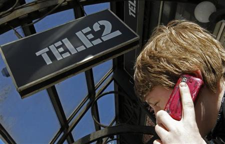 A man talks on a telephone outside a branch of Nordic telecoms group Tele2 in St. Petersburg, March 28, 2013. REUTERS/Alexander Demianchuk