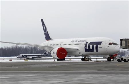 A Dreamliner belonging to Polish airline LOT is being parked on the tarmac at Chopin International Airport in Warsaw February 13, 2013. REUTERS/Peter Andrews