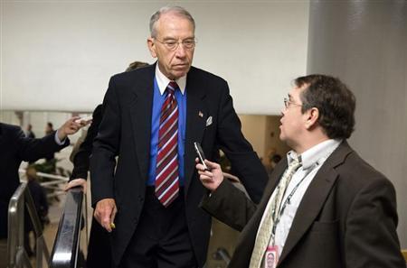 Senator Charles Grassley, (R-IA), speaks to a reporter on Capitol Hill in Washington November 13, 2012. REUTERS/Joshua Roberts