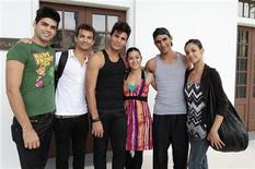 Dancers (L-R) Edward Gonzalez Morgado, Randy Crespo, Luis Victor Santana, Annie Ruiz Diaz, Josue Justiz and Arianni Martin from the Cuban National Ballet, who defected last month, pose for a photo before their audition at the Miami Hispanic Ballet in Miami, Florida April 4, 2013. Reuters/Joe Skipper