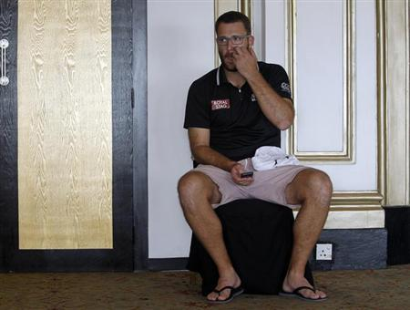 New Zealand's Daniel Vettori waits for his turn for an open session news conference ahead of the World Twenty20 cricket series in Colombo September 14, 2012. REUTERS/Dinuka Liyanawatte/Files