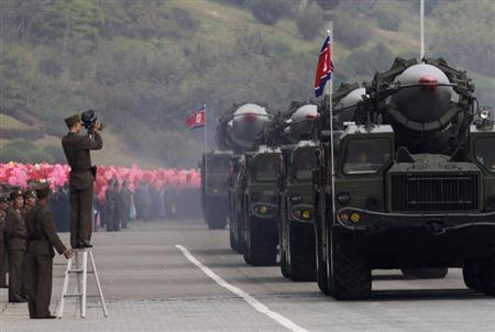 A North Korean soldier films military vehicles carrying missiles during a parade to commemorate the 65th anniversary of founding of the Workers' Party of Korea in Pyongyang October 10, 2010. REUTERS/Petar Kujundzic