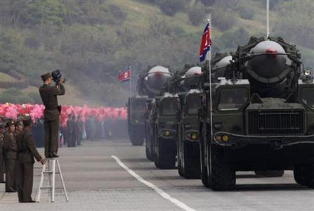 A North Korean soldier films military vehicles carrying missiles during a parade to commemorate the 65th anniversary of founding of the Workers' Party of Korea in Pyongyang October 10, 2010. REUTERS-Petar Kujundzic