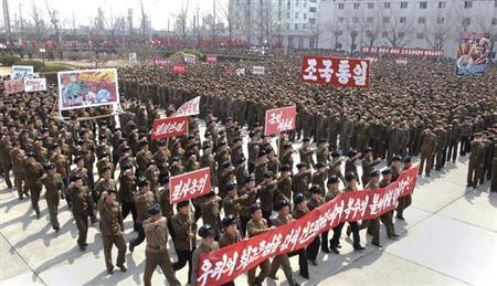 North Koreans attend a rally held to gather their willingness for a victory in a possible war against the United States and South Korea in Nampo, North Korea, April 3, 2013 in this picture released by the North's official KCNA news agency in Pyongyang on Wednesday. REUTERS/KCNA