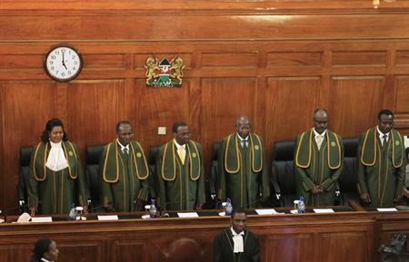 Kenya's Chief Justice Willy Mutunga (3rd L) leads the Supreme Court Judges Njoki Ndungu (L-R), Philip Tunoi, Jackton Ojwang, Mohamed Ibrahim and Smokin Wanjala, in Kenya's capital Nairobi, March 30, 2013. REUTERS/Noor Khamis