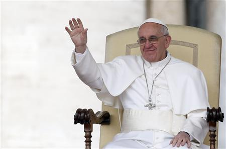 Pope Francis waves as he leads the weekly general audience in Saint Peter's square, at the Vatican April 3, 2013. REUTERS/Stefano Rellandini