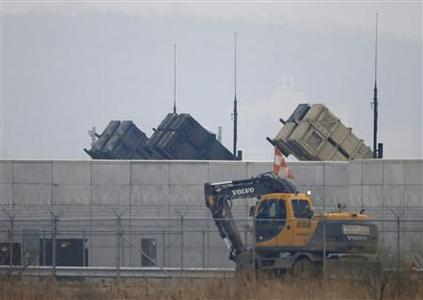 An excavator moves past U.S. Army Patriot missile air defence artillery batteries at U.S. Osan air base in Osan, south of Seoul April 5, 2013. REUTERS-Lee Jae-Won