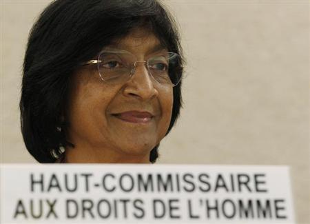 U.N. High Commissioner for Human Rights Navi Pillay smiles before delivering her annual report to the 22nd session of the Human Rights Council at the United Nations in Geneva February 28, 2013. REUTERS/Denis Balibouse/Files