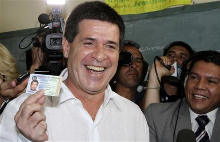 Horacio Cartes from the Colorado Party shows his identity card before voting in the primaries of the party in Asuncion December 9, 2012. REUTERS/Stringer (PARAGUAY - Tags: POLITICS ELECTIONS) - RTR3BDXS