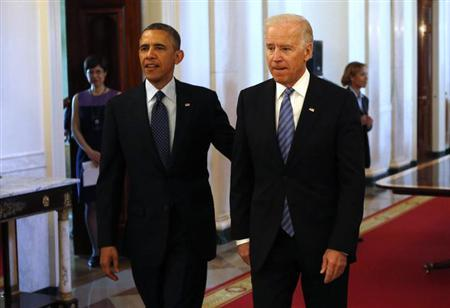U.S. President Barack Obama and Vice President Joe Biden arrive for the Easter Prayer Breakfast held in the East Room of the White House in Washington April 5, 2013. REUTERS/Kevin Lamarque