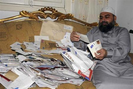 Egyptian cleric Hassan Mustafa Osama Nasr, also known as Abu Omar, shows letters of well wishes from his supporters from around the world during a Reuters interview in his house in Alexandria, Egypt May 13, 2008. REUTERS/Stringer (EGYPT)