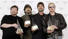 "Members of the country band ""Alabama"" pose with their Award of Merit at the 30th annual American Music Awards in Los Angeles, January 13, 2003. From left are Jeff Cook, Randy Owen, Teddy Gentry and Mark Herndon."