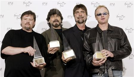 Members of the country band ''Alabama'' pose with their Award of Merit at the 30th annual American Music Awards in Los Angeles, January 13, 2003. From left are Jeff Cook, Randy Owen, Teddy Gentry and Mark Herndon.
