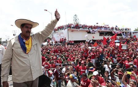 Venezuela's acting President and presidential candidate Nicolas Maduro waves to supporters during a campaign rally in the state of Cojedes April 4, 2013, in this picture provided by the Miraflores Palace. REUTERS/Miraflores Palace/Handout