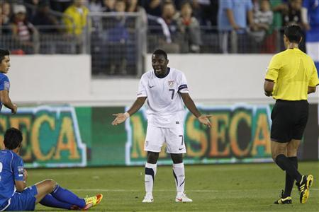 Freddy Adu of the U.S. (C) reacts to getting a yellow card during their CONCACAF Olympic qualifying soccer match against El Salvador in Nashville, Tennessee March 26, 2012. REUTERS/Harrison McClary